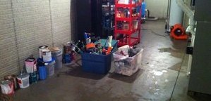 Cleaning Up Flooded Garage After Sewage Overflow