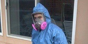 Water Damage Restoration Technician With Mold Cleanup Tools