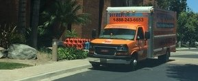 Water and Mold Damage Restoration Truck At Job Location
