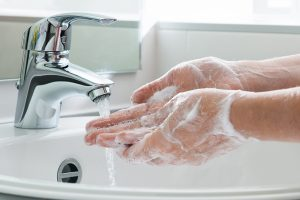 washing hands in sink coronavirus